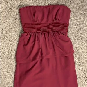 Burgundy strapless peplum floor length gown